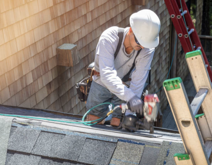roofing contractor with white hat with stapling gun Burbank CA